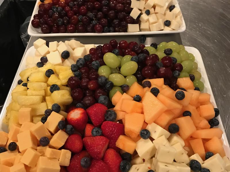 Cheese and fruit platter on table